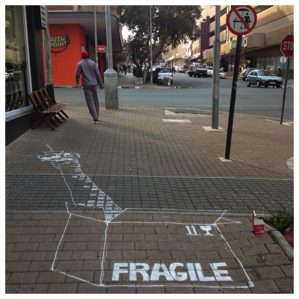 The start of a chalk drawing by Tania from Past Experiences walking tours - outside Doubleshot, Braamfontein
