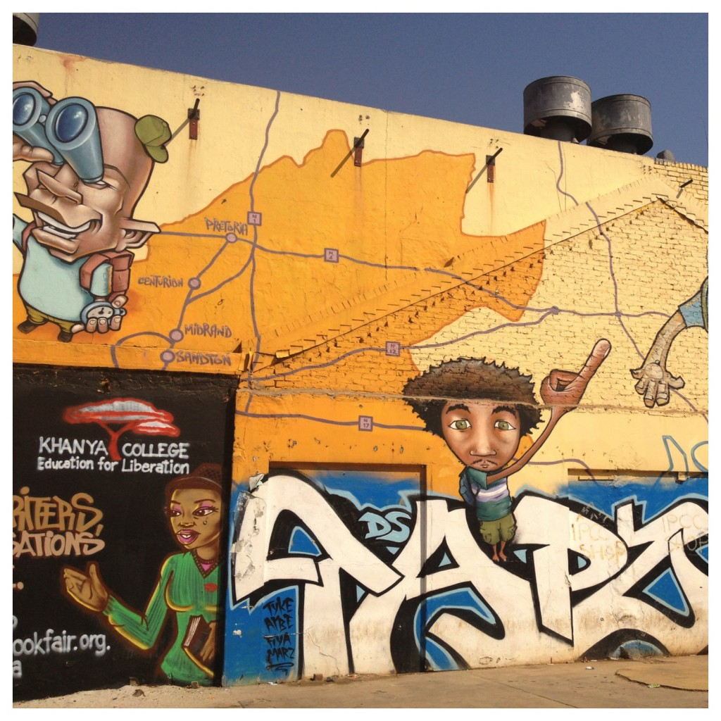 A graffiti campaign for Gauteng tourism On Miriam Makeba Street, advert for the Jozi Book Festival and Tapz was here