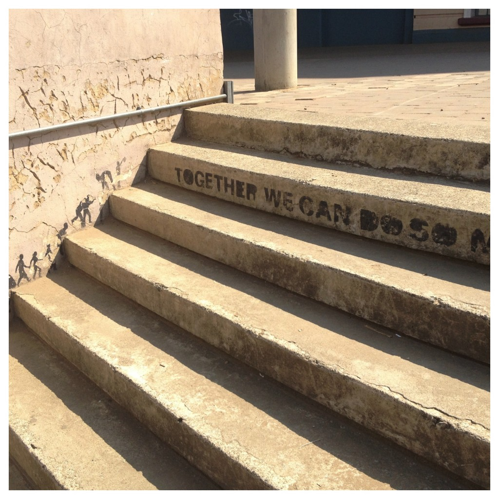Together we can do so much. A bit of whimsy on the steps of Museum Africa